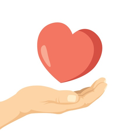 Hand holding heart as symbol of charity