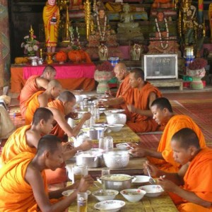 Monks eating in Cambodia