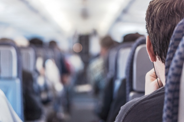 Man sitting in airplane seat