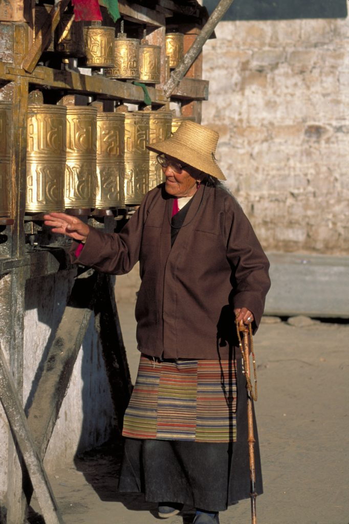 Tibet Lhasa Barkor Woman and Prayer Wheels